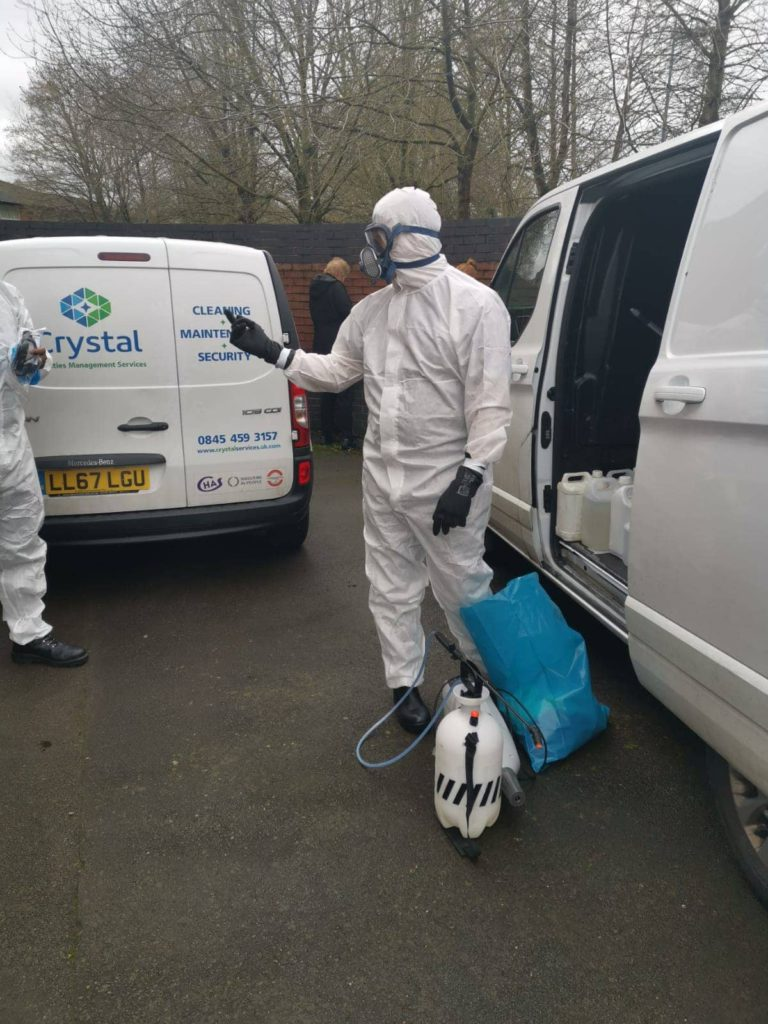 disinfection cleaning operatives in hazmat suites