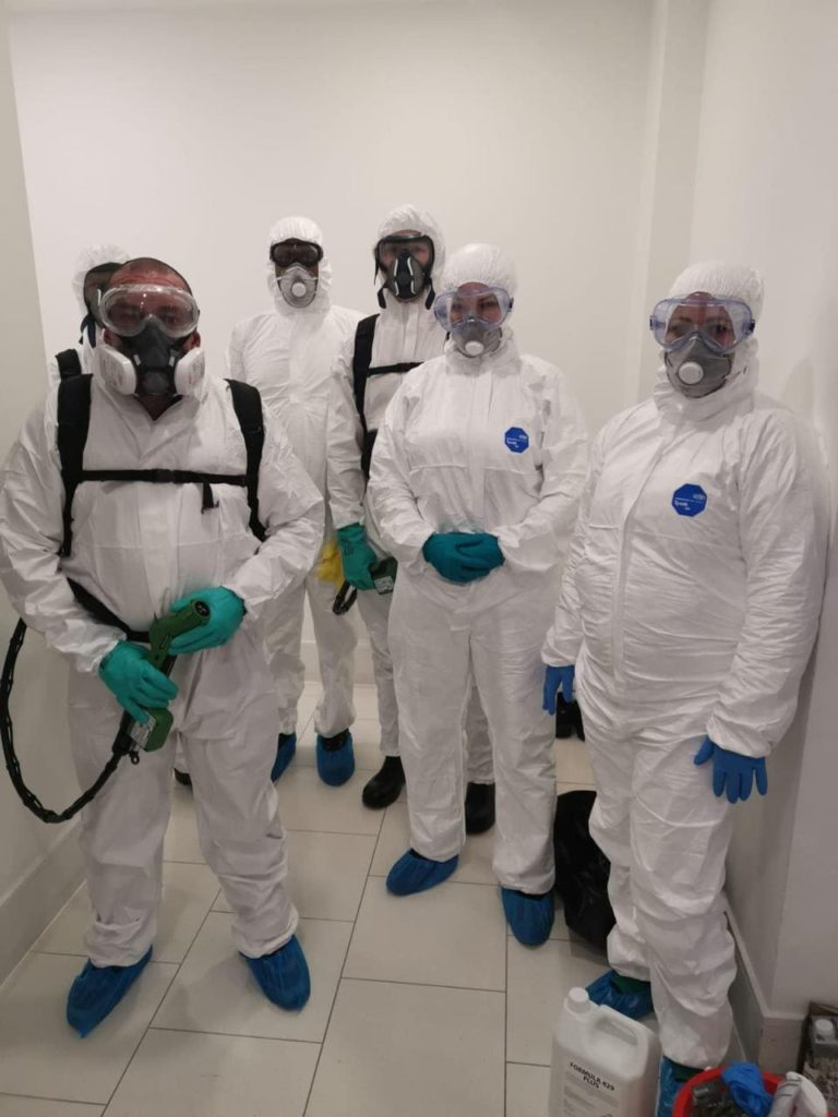 disinfection cleaning operatives ready to clean, sanitise and disinfect